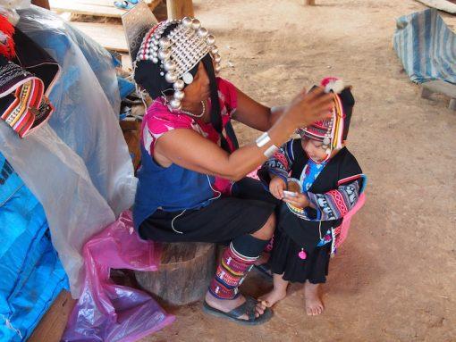 dressing an Akha child Akha woman Chiang Mai Tribal Photography tour