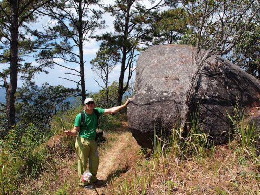 Doi Suthep Day Trekking Alan Dovey standing against a boulder