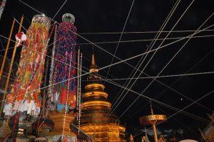 Chedi of Wat Hariphunchai amidst donation trees Salak Yom Festival Lamphun 2018
