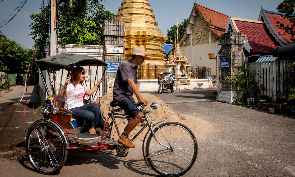 bicycle taxi with tourist