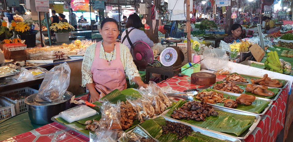woman selling at a market