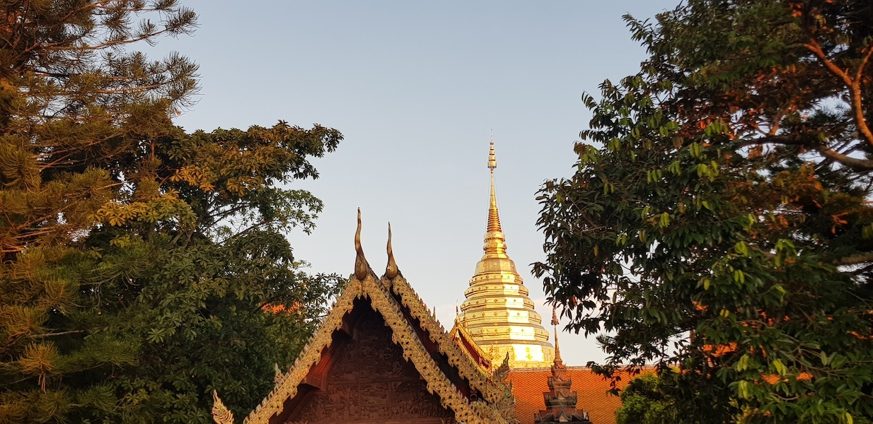 Buddhist temple with golden chedi