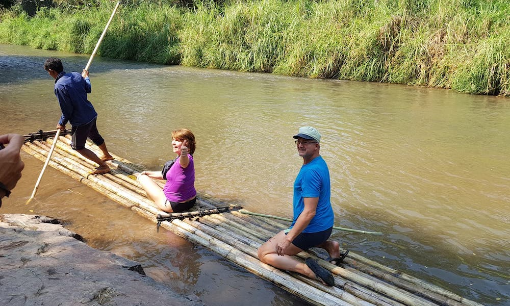 Two tourists on a bamboo raft