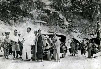 Group of people and a vehicle