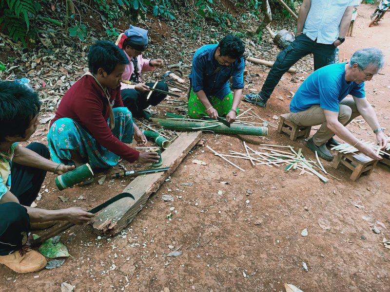 people cutting bamboo