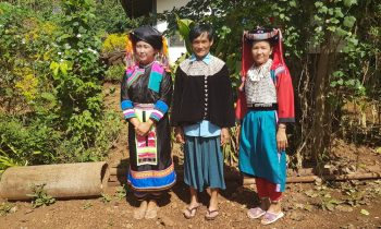 Three people in tribal dress