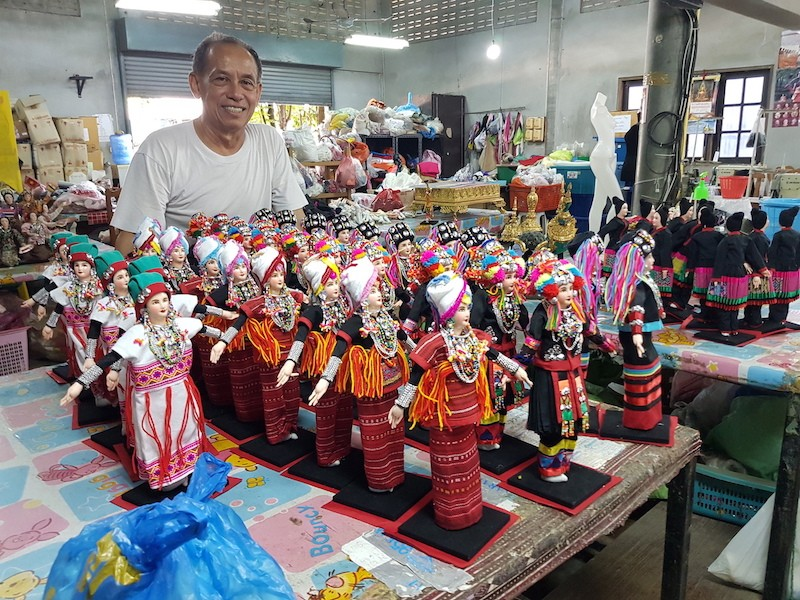 Man with handicraft dolls Intangible Cultural Heritage of Chiang Mai