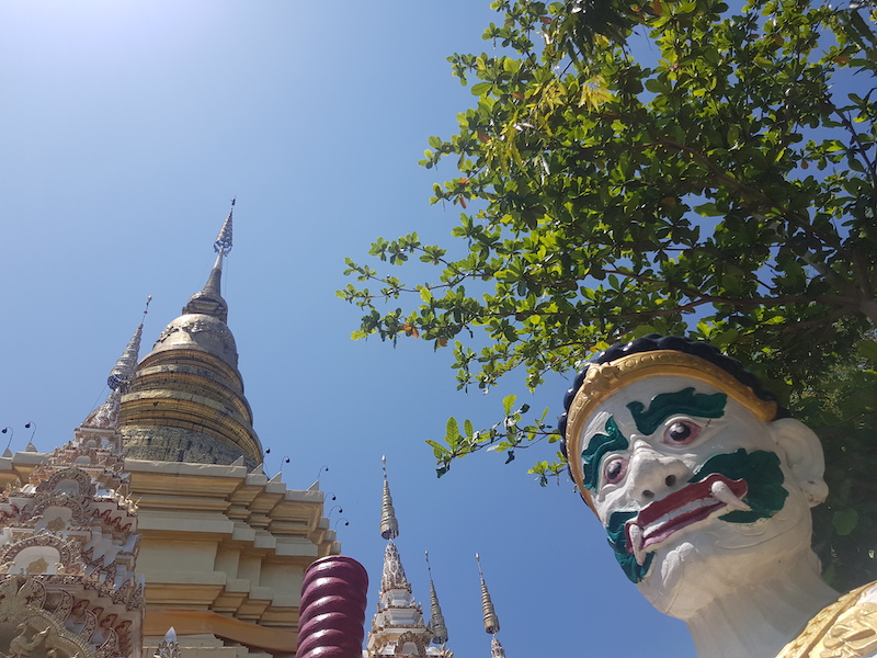 Golden chedi with head