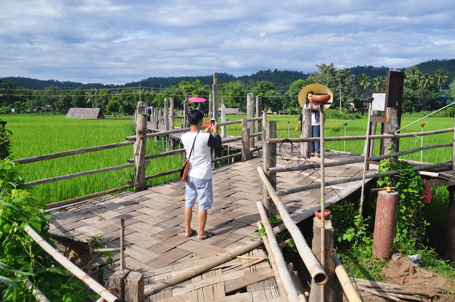 People on bamboo bridge