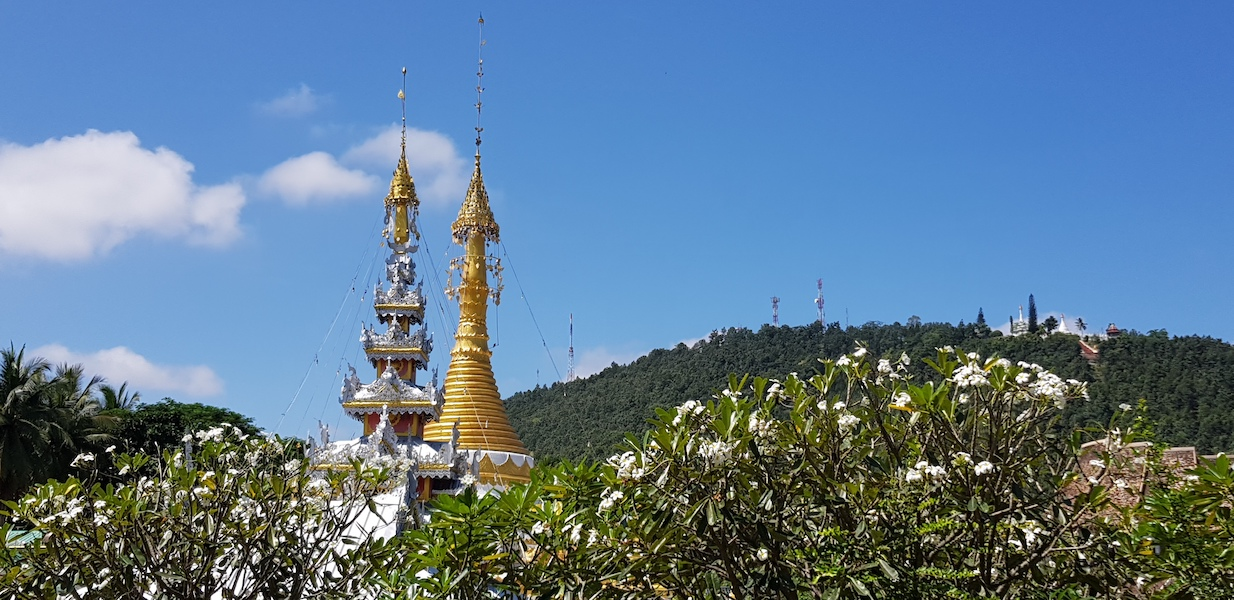 Two chedi with a mountain