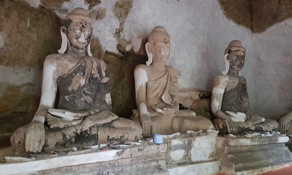 Old Buddha statues in a cave