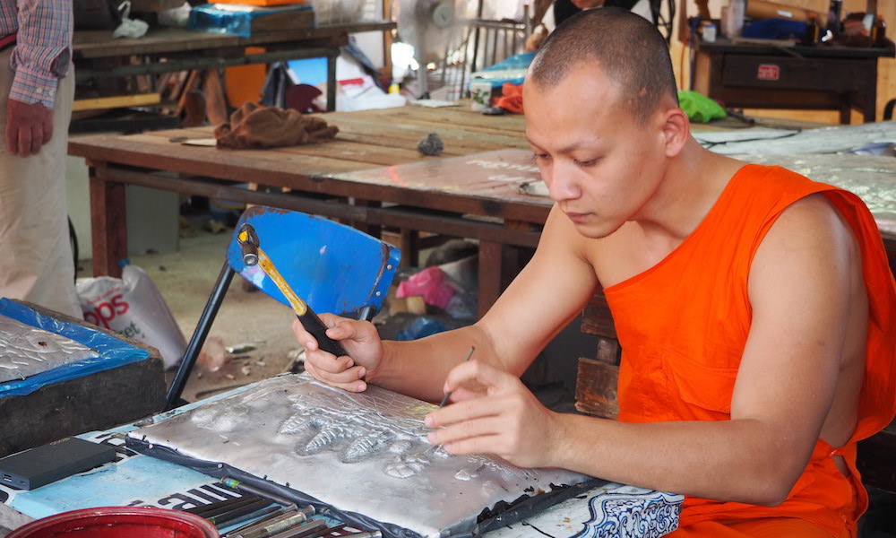 Monk working on silver