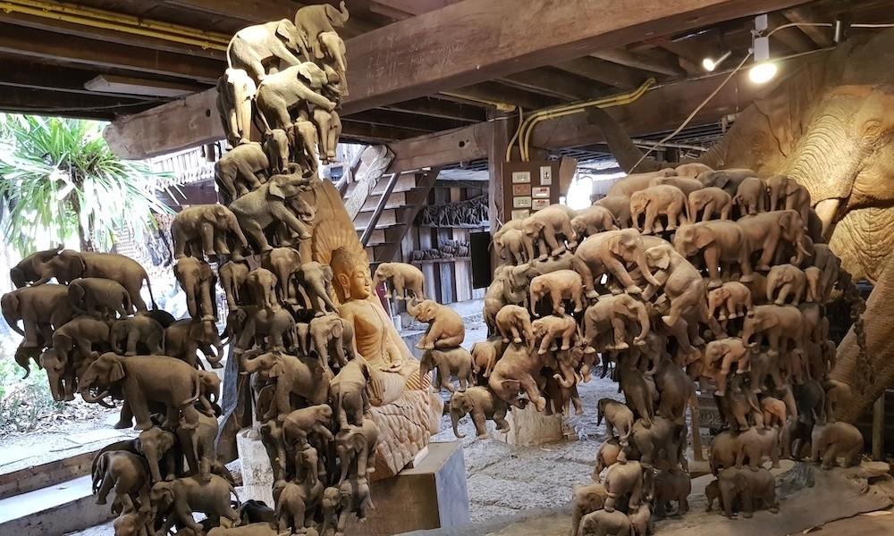 Many wooden elephants