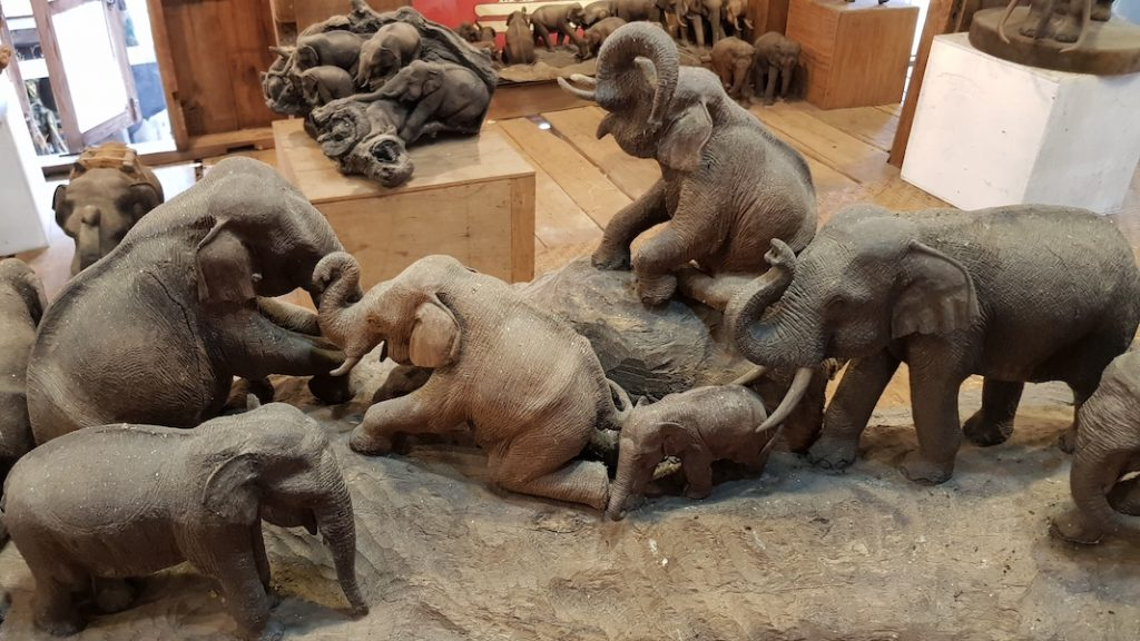 Lots of wooden elephants