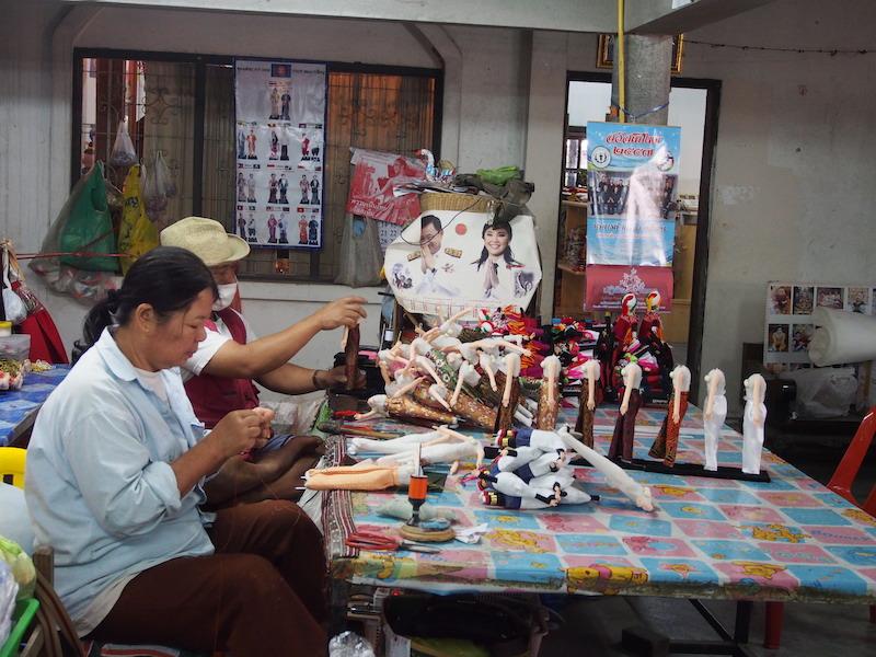 People making dolls