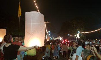 Tourist releasing sky lantern Loy Krathong tour