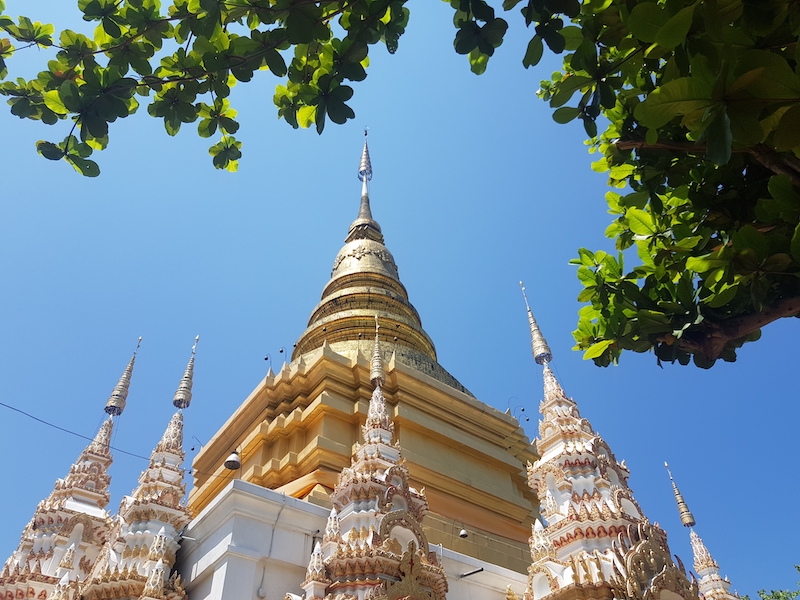 Golden chedi with green leaves
