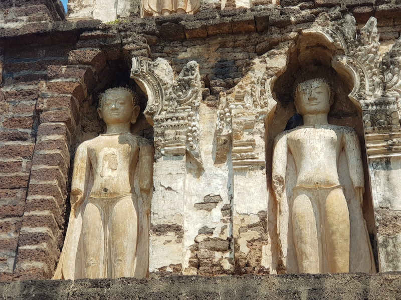 Two buddha statues in chedi