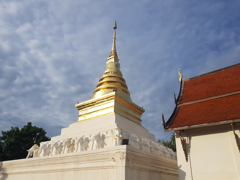 Golden chedi with elephants