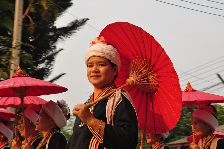 Woman in traditional dress with umbrella