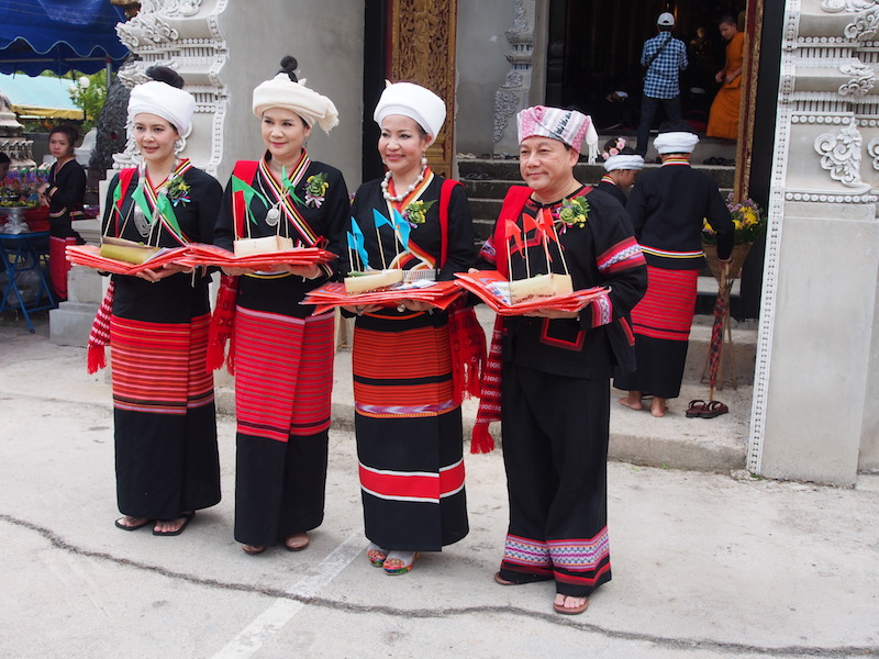 Three women and one men in traditional dress