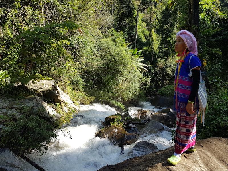 Tribal woman at waterfall