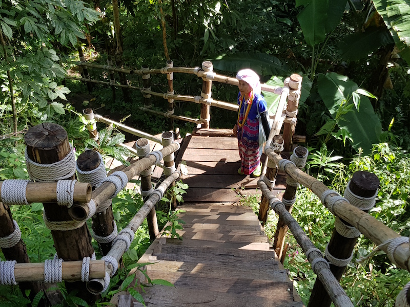 tribal woman on bamboo stairs