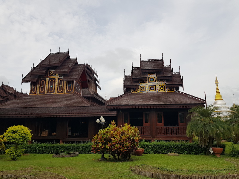 Wooden temple and chedi