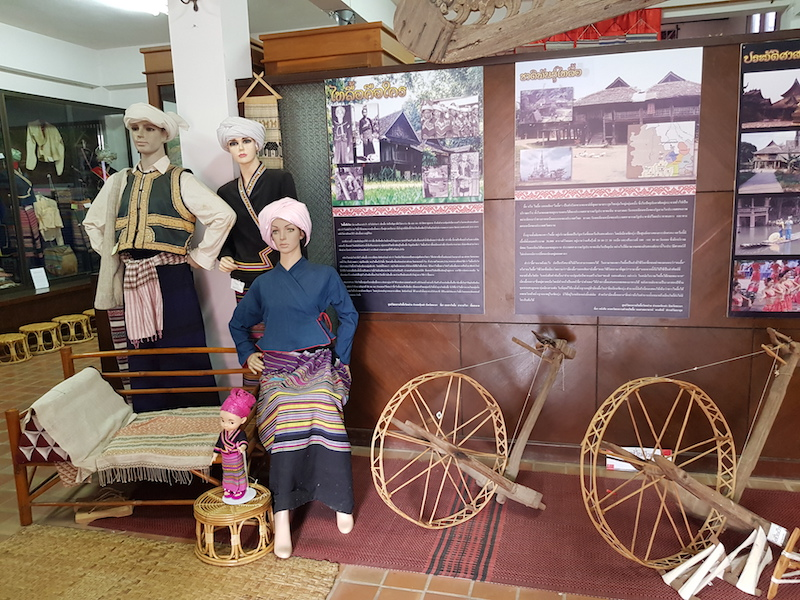 Dolls in traditional dress and bicycle