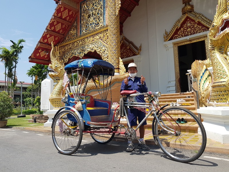 Bicycle taxi in front of a temple