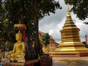 Buddha image and gilded chedi
